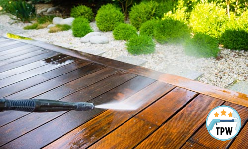A pressure washer cleaning the exterior of a home entertainment area